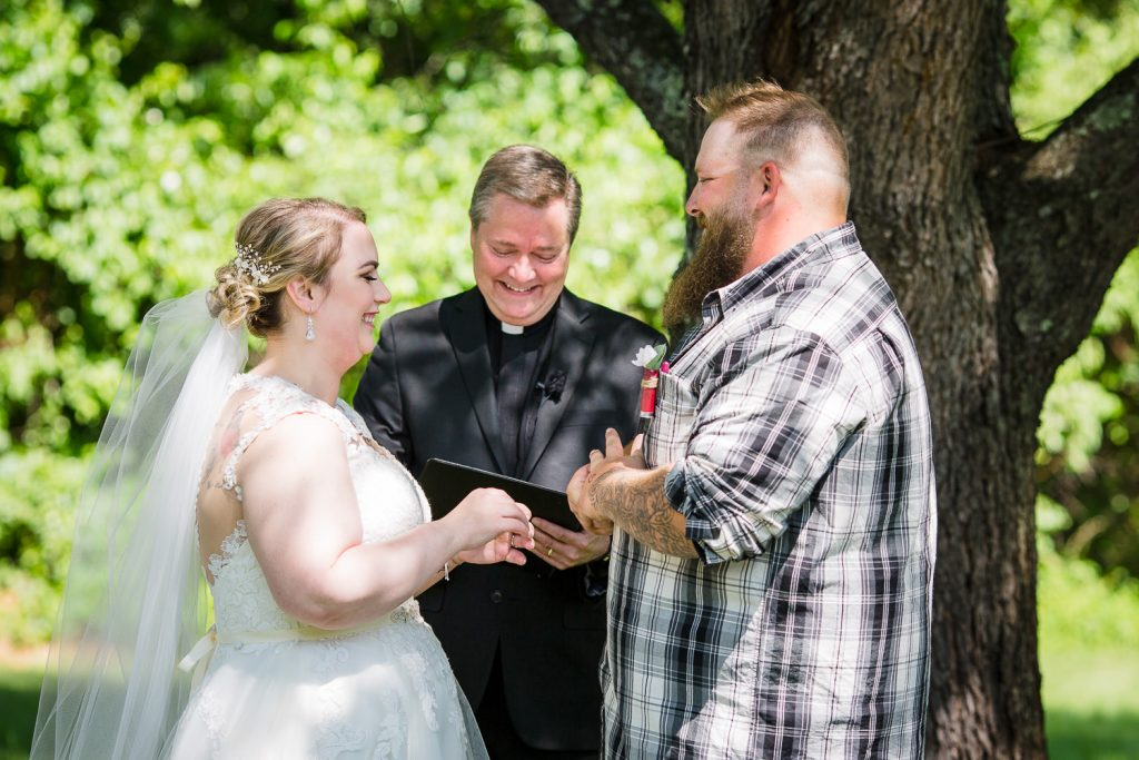 Wedding exchange of vows at an outdoor wedding in central MA.
