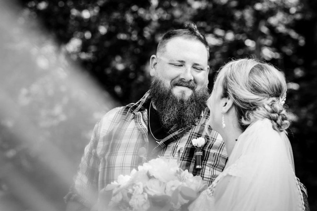 A groom looks at his bride during wedding photography at the 228 Sterling.