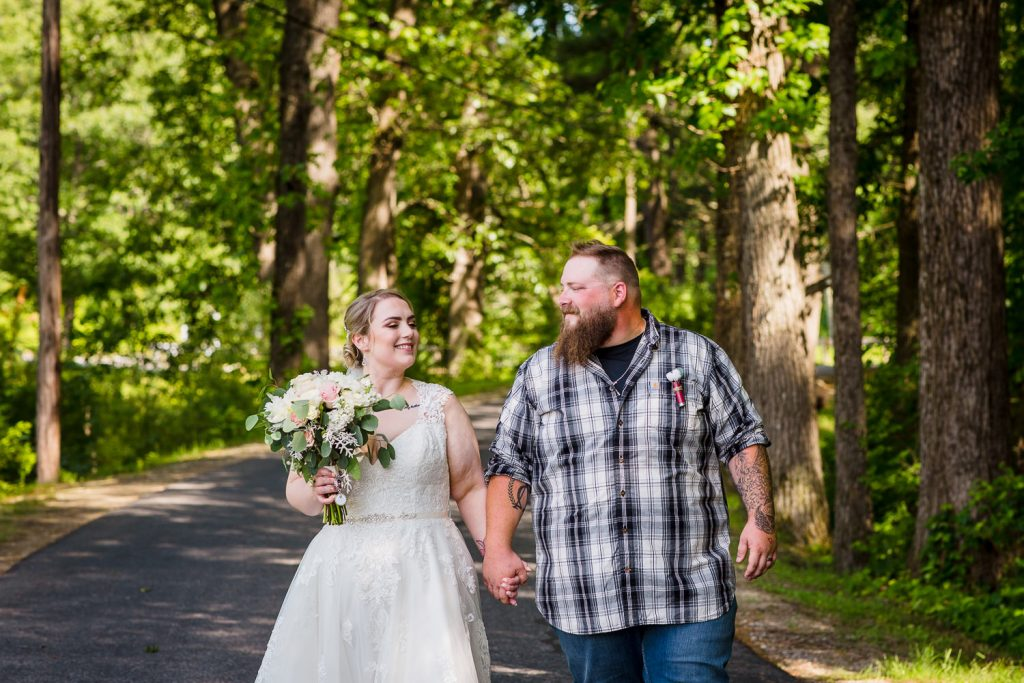 Wedding photography of a bride and groom walking in central MA.