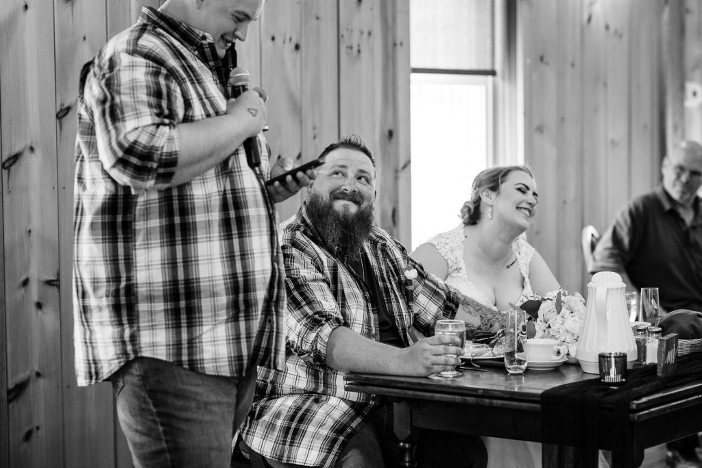 Wedding speech reactions during a barn wedding at the 228 in Sterling MA