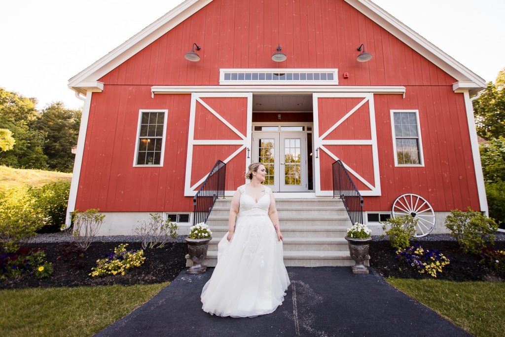 Bride stands in front of the barn at 228 Sterling central ma barn wedding