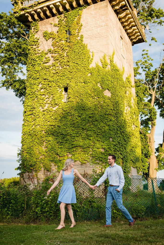 A couple beneath the water tower at Harkness Park during their engagement photos
