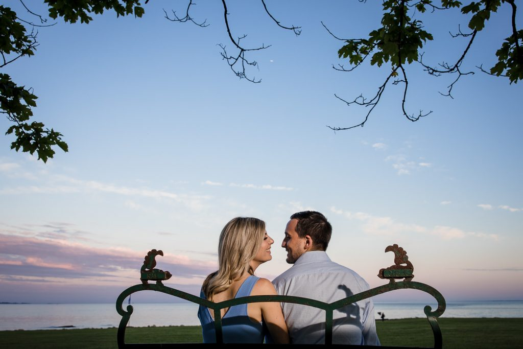 A couple enjoys sunset at Harkness Memorial Park during their engagement photo session in Connecticut