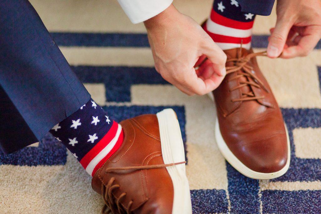 Groom getting ready in american flag attire for wedding in Bristol, RI