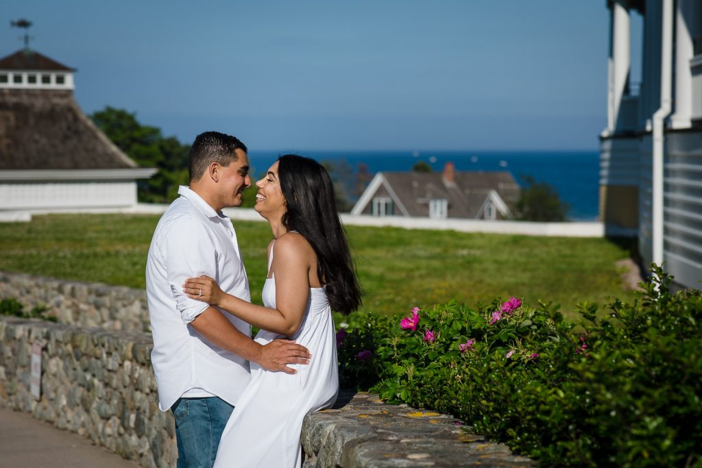 A couple in white at their Watch Hill Rhode Island engagement photo session