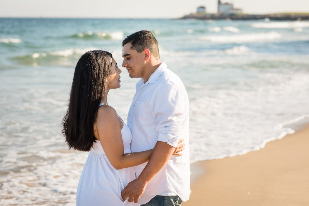 A couple in white at their East Beach Westerly Rhode Island engagement photo session
