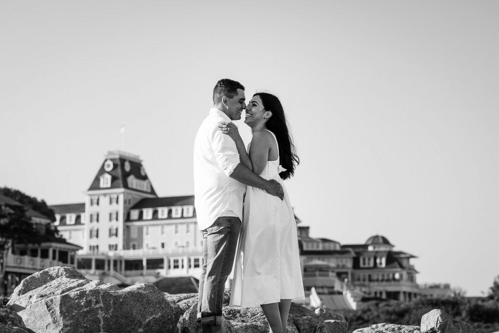 A couple in white at their Ocean House Watch Hill Rhode Island engagement photo session