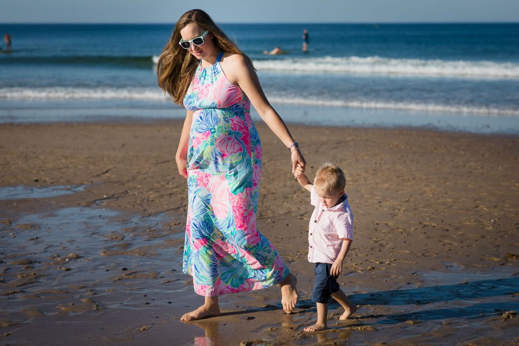 A family in pink and blue during a cape cod family photo session on Newcomb Hollow Beach in Wellfleet Cape Cod