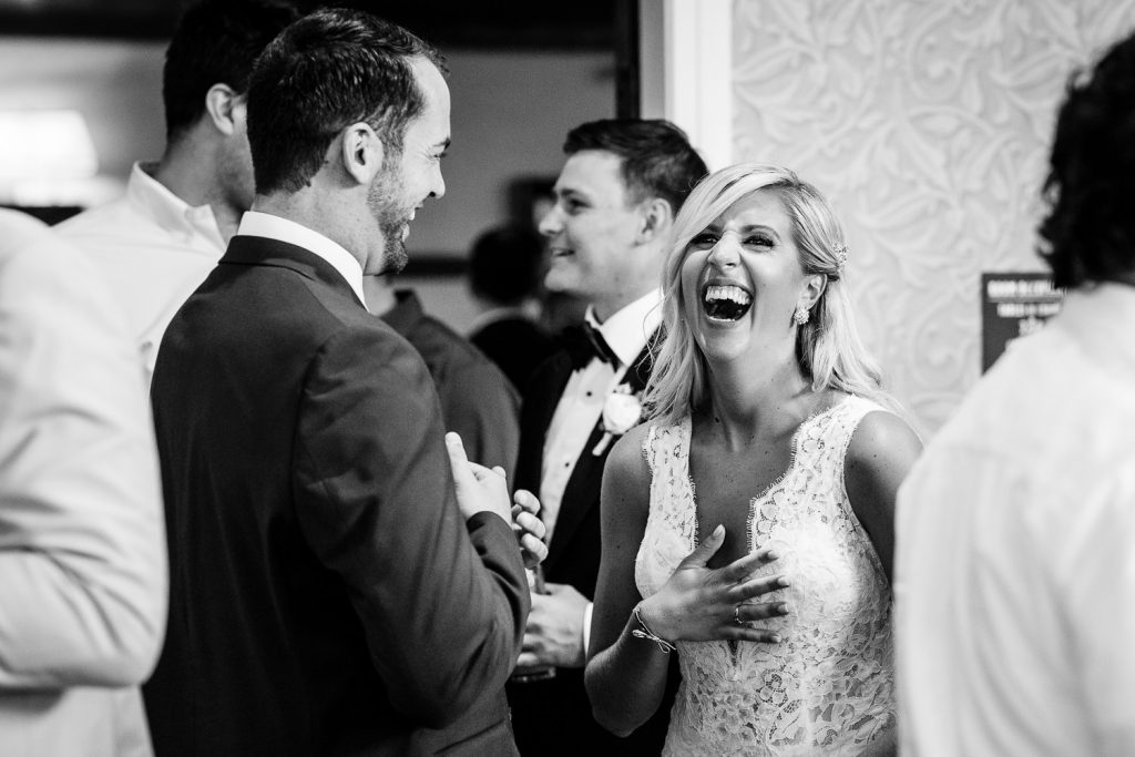 Candid wedding photography at Lake of Isles CT wedding