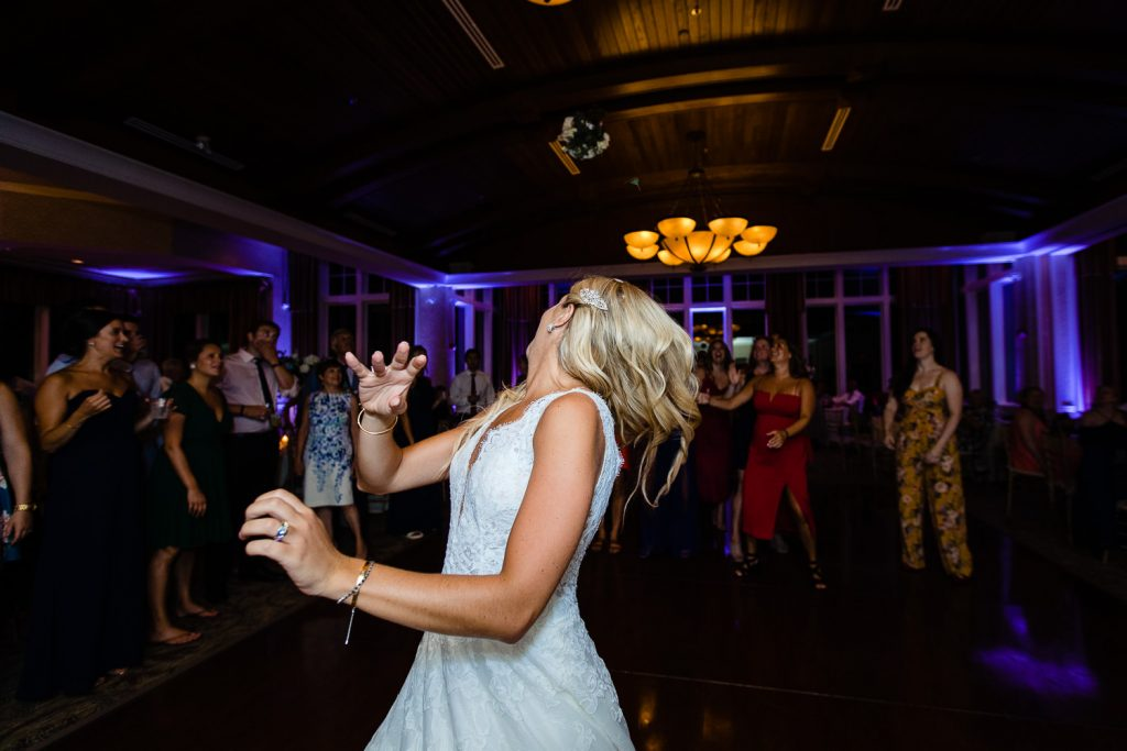Bride throws bouquet at Lake of Isles Foxwoods Wedding