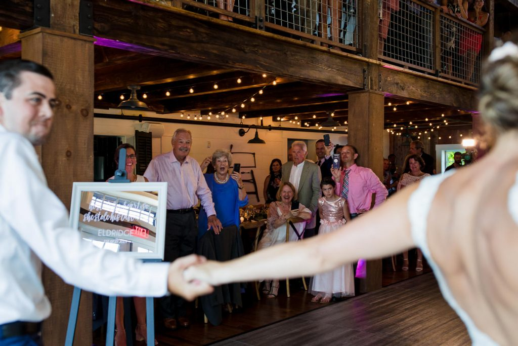 The bride and groom's dirty dancing wedding entrance to their wolfeboro nh wedding reception