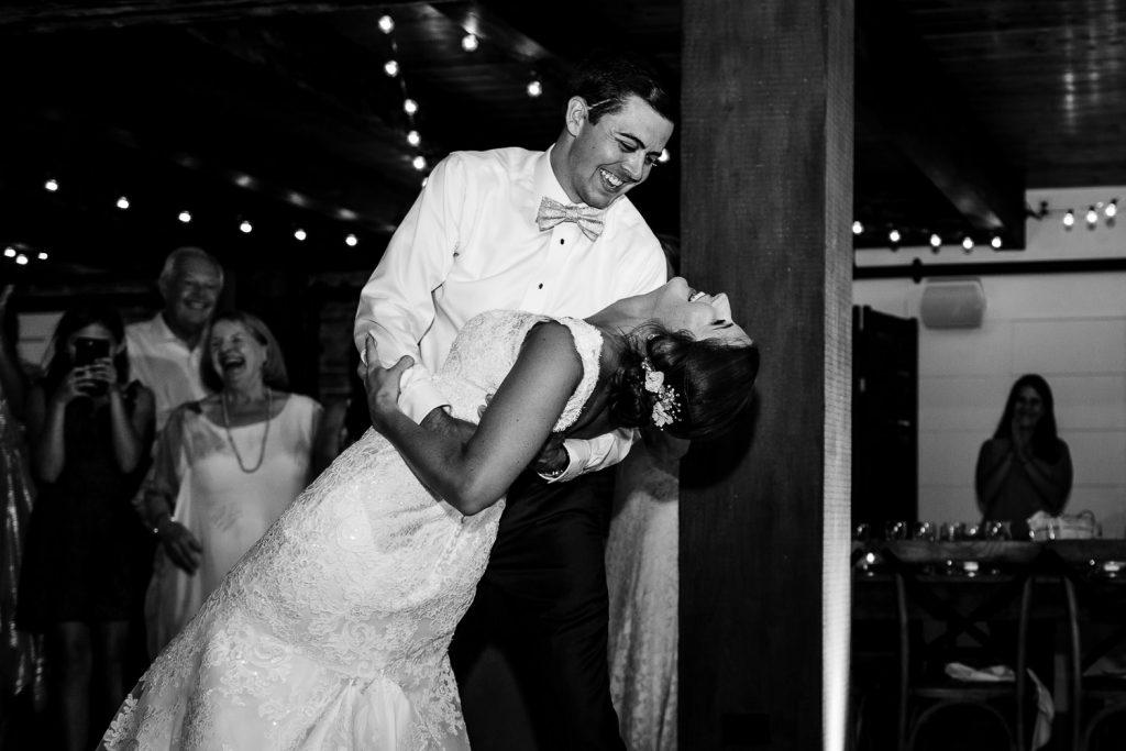 The groom dips the bride during their first dance at The Barn at Pickering House in Wolfeboro, NH