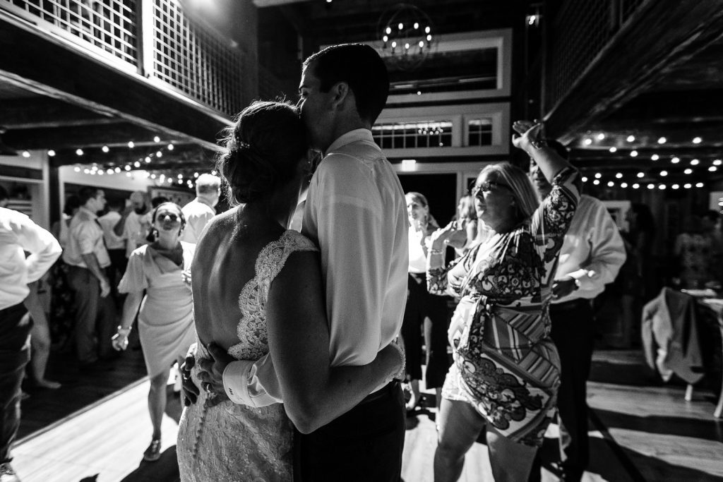 The wedding couple embraces on the dance floor at the Barn at Pickering House
