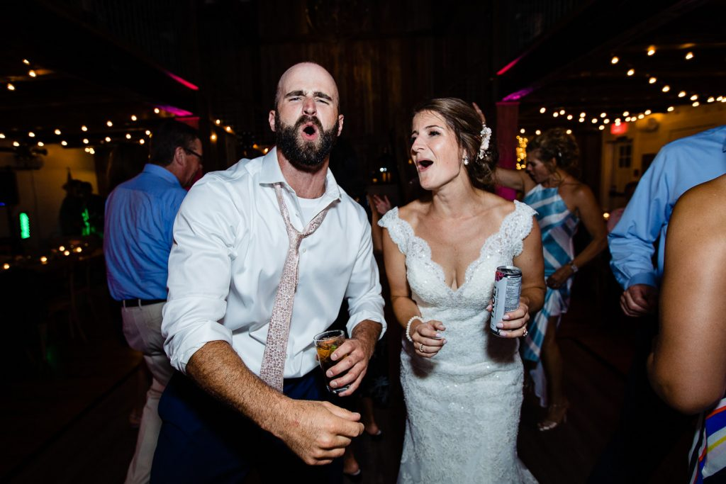 The bride sings with her brother at the barn at pickering house