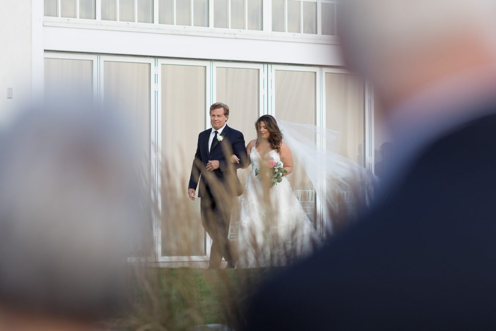 Bride and father walking down aisle at belle mer newport wedding ceremony