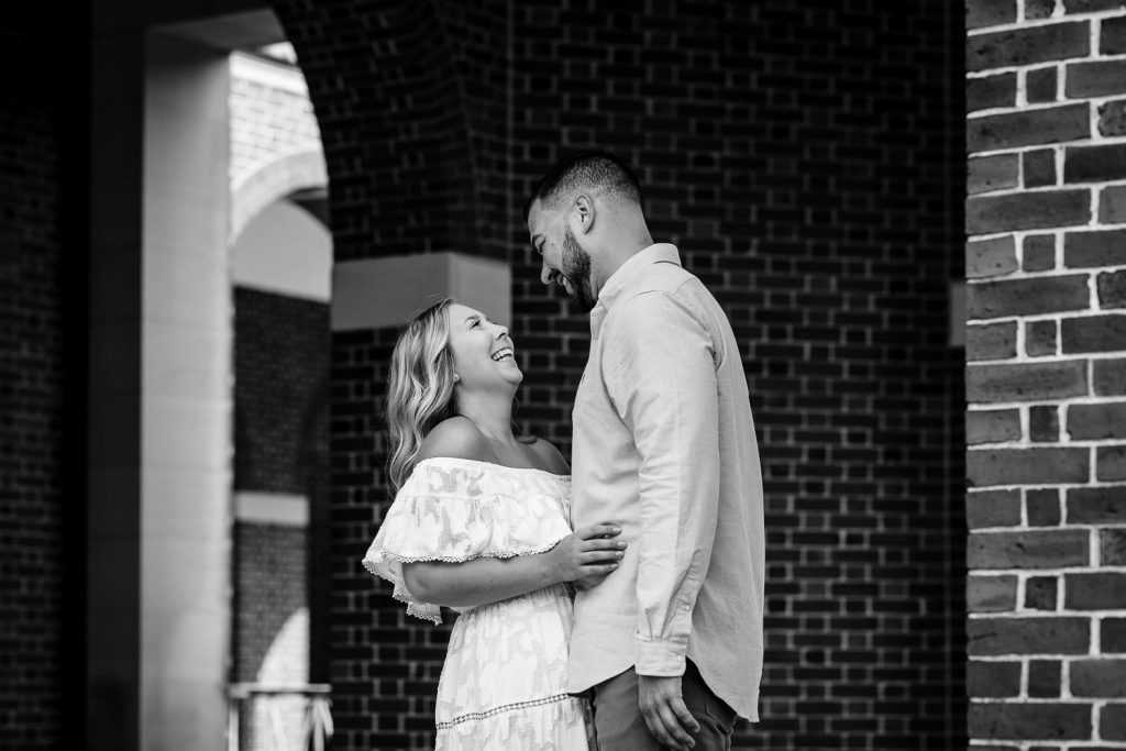 Couple posing for engagement photos at Hall of Springs in Saratoga Springs, NY
