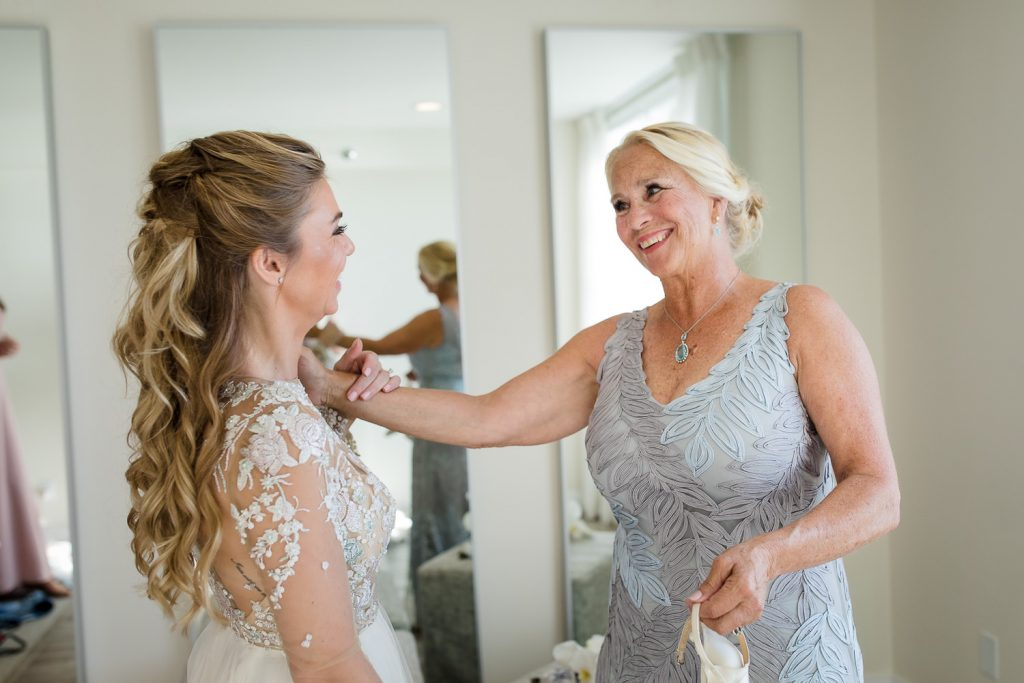 mother of the bride reacts to seeing her daughter