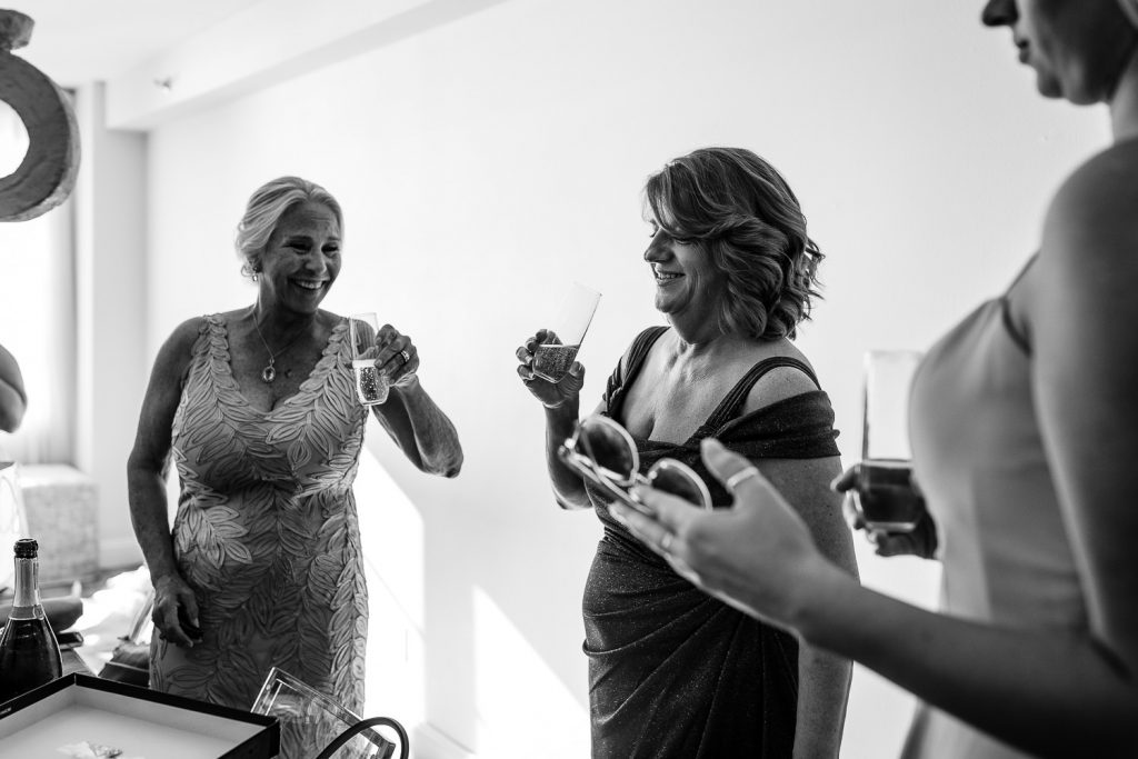mothers laugh and toast at wedding