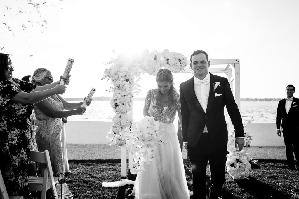 bride and groom ceremony exit with confetti canons