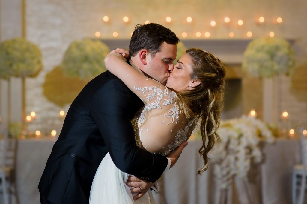 couple kisses during first wedding dance