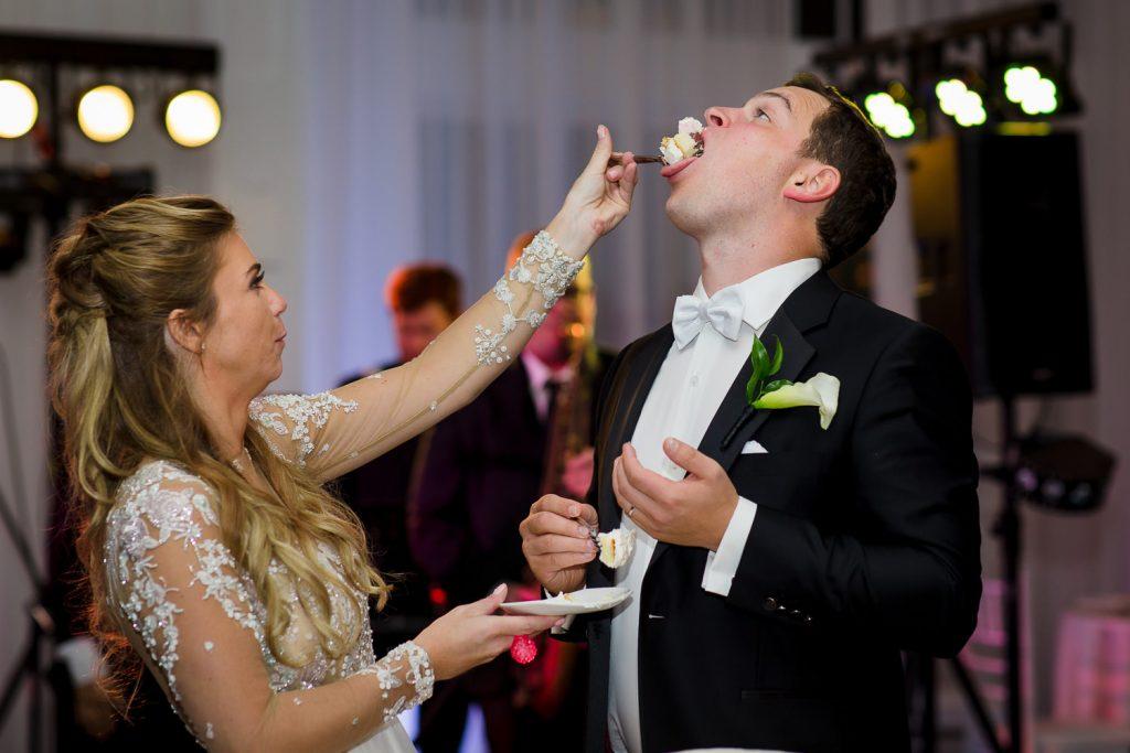 bride feeds groom cake