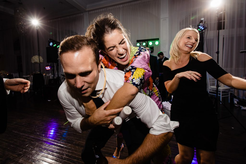 wedding guests dance and give piggy back rides in newport ri