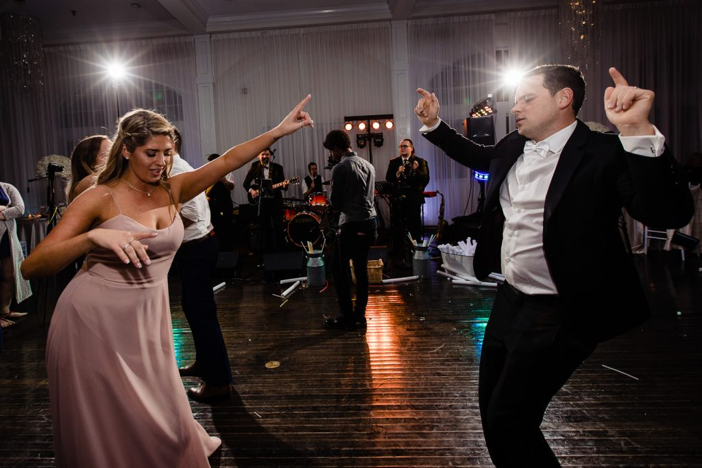 groom and his sister dancing at belle mer wedding