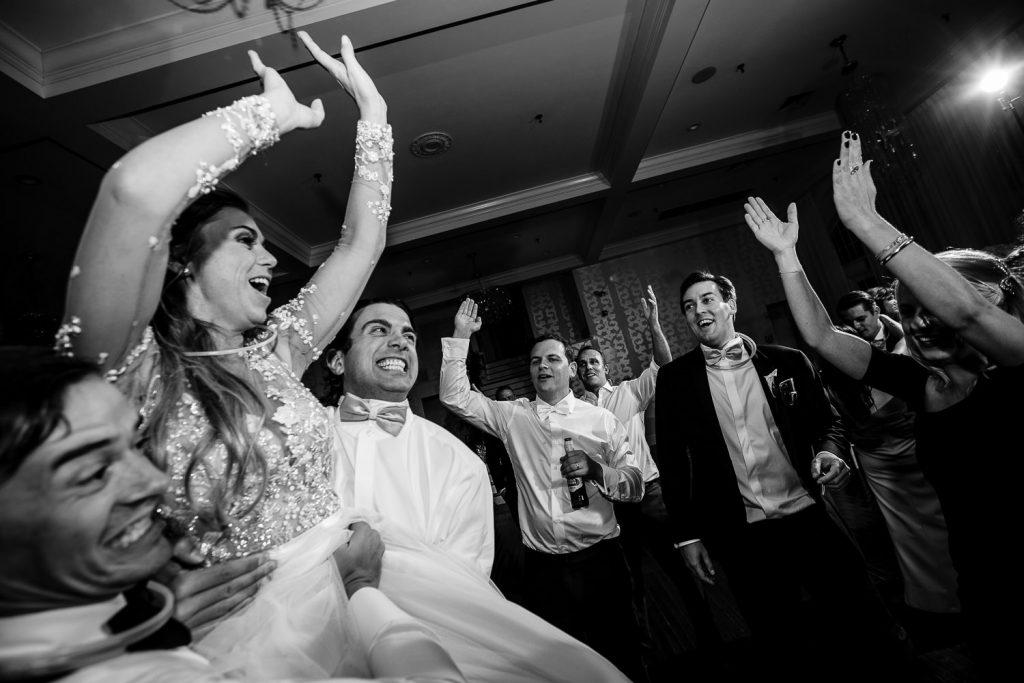 bride dancing at belle mer wedding