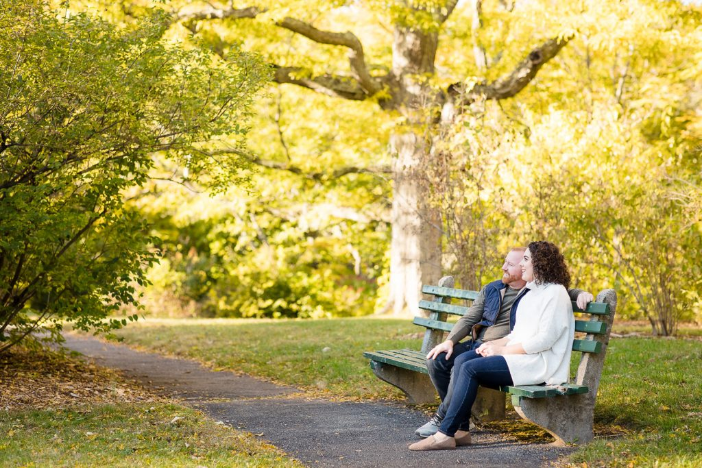 man and woman on park bench in arnold arboretum boston