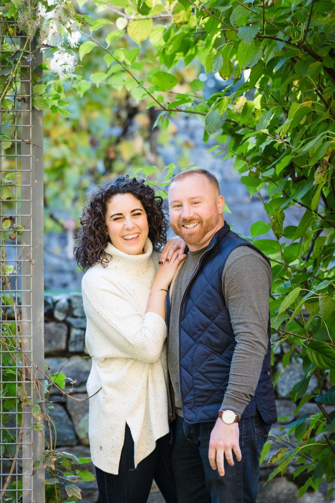 engaged couple laugh in vine garden