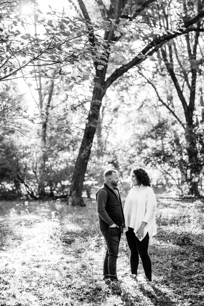 backlit photo of man and woman in woods
