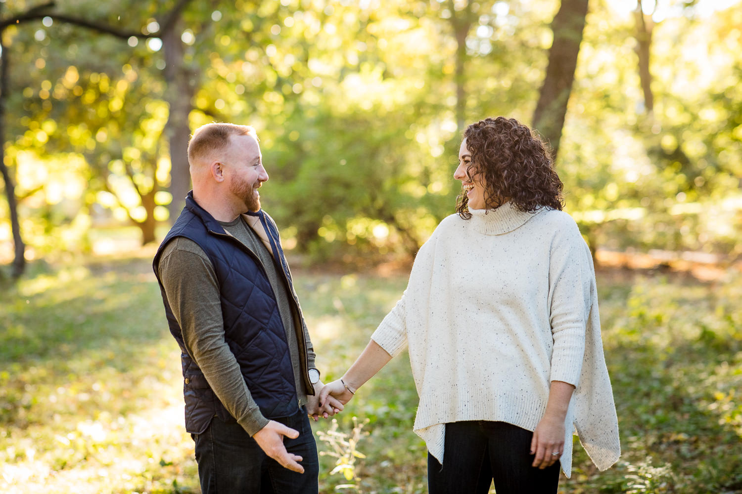 couple laughs for engagement photos at arnold arboretum