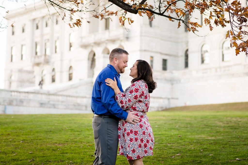 couple pose in front of rhode island state house