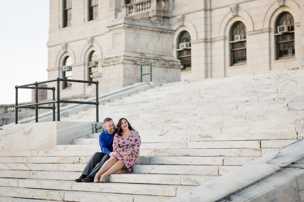 couple sit on steps of state house