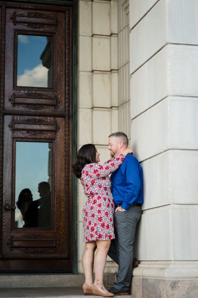 couple lean against rhode island state house