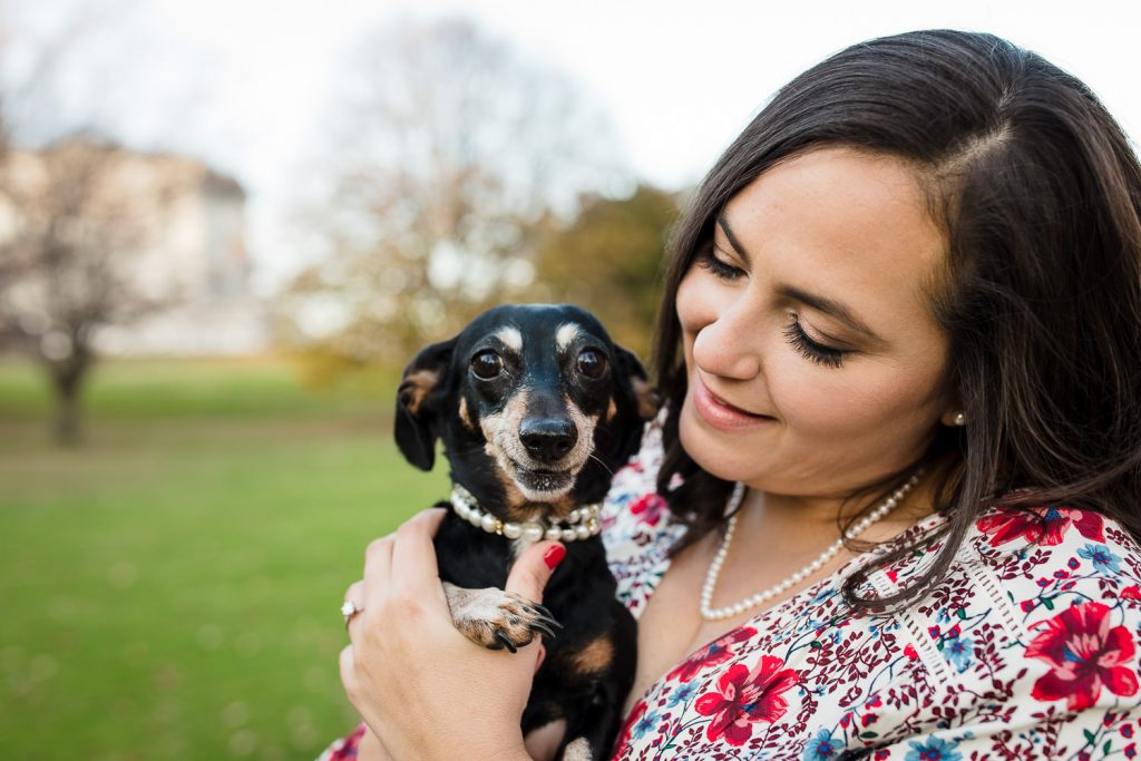 woman and dog both wearing pearls