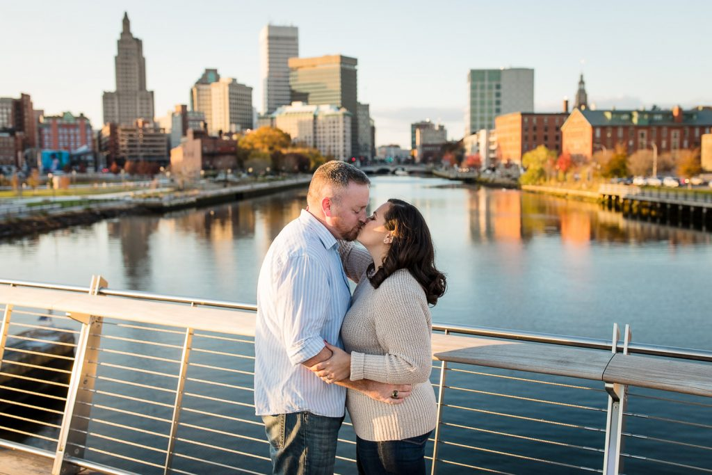 couple on pedestrian bridge with providence skyline