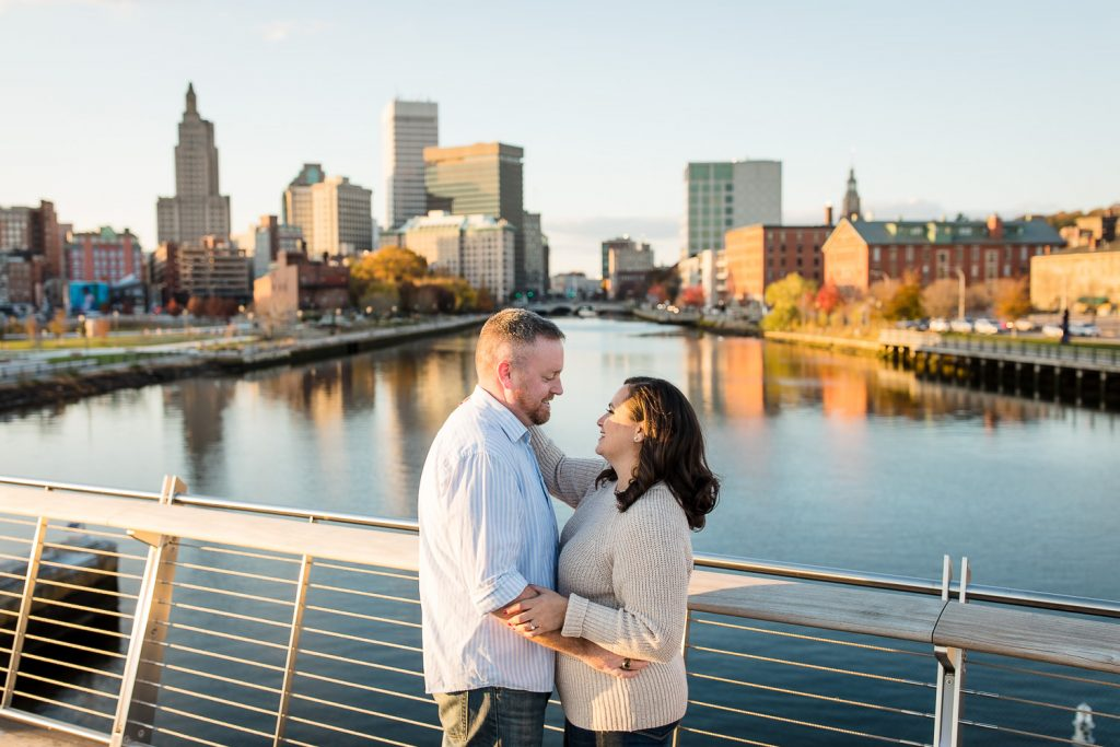 couple on providence pedestrian bridge for engagement photos
