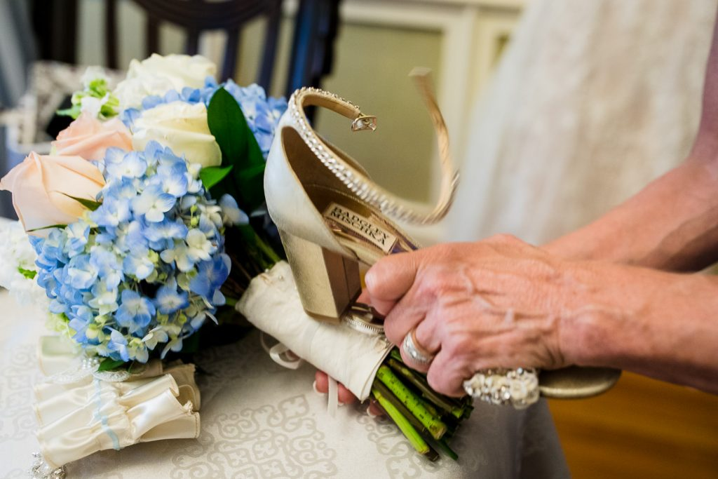 Using a high heeled shoe to hammer a wedding bouquet
