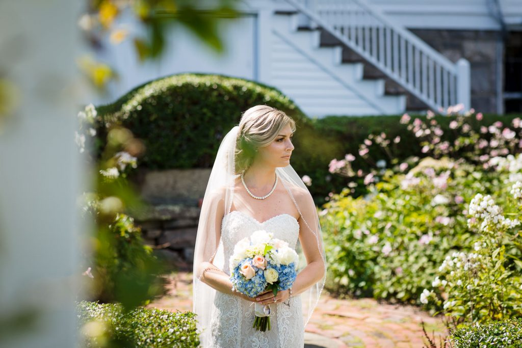Bride waiting in a beautiful garden