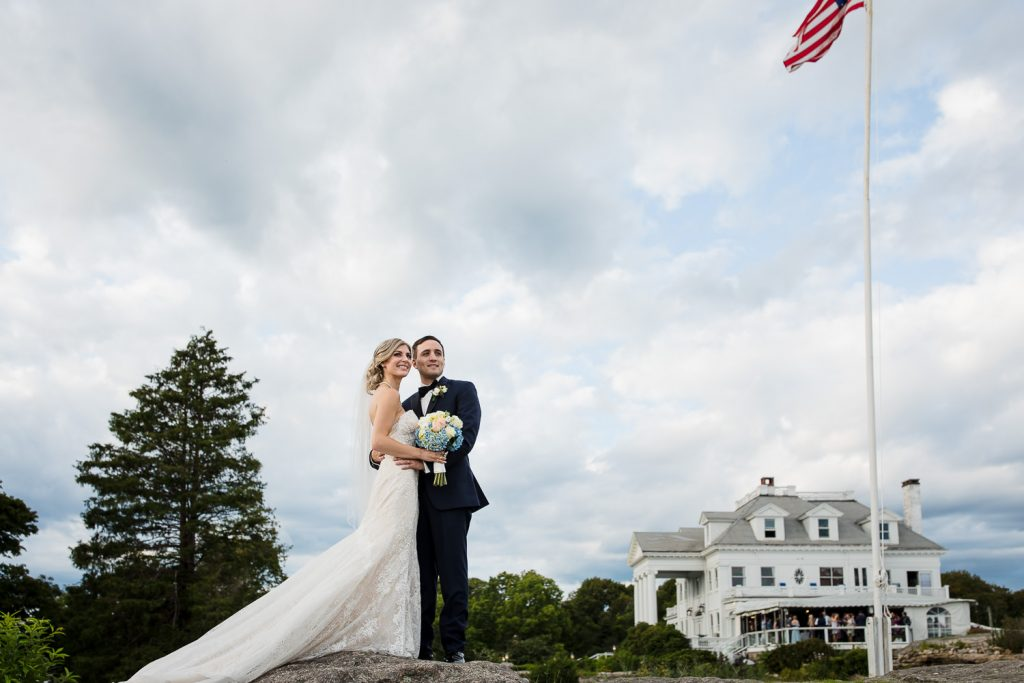 Bride and groom in front of haley mansion at inn at mystic