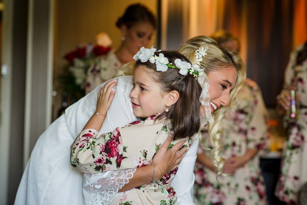 flower girl hugs bride