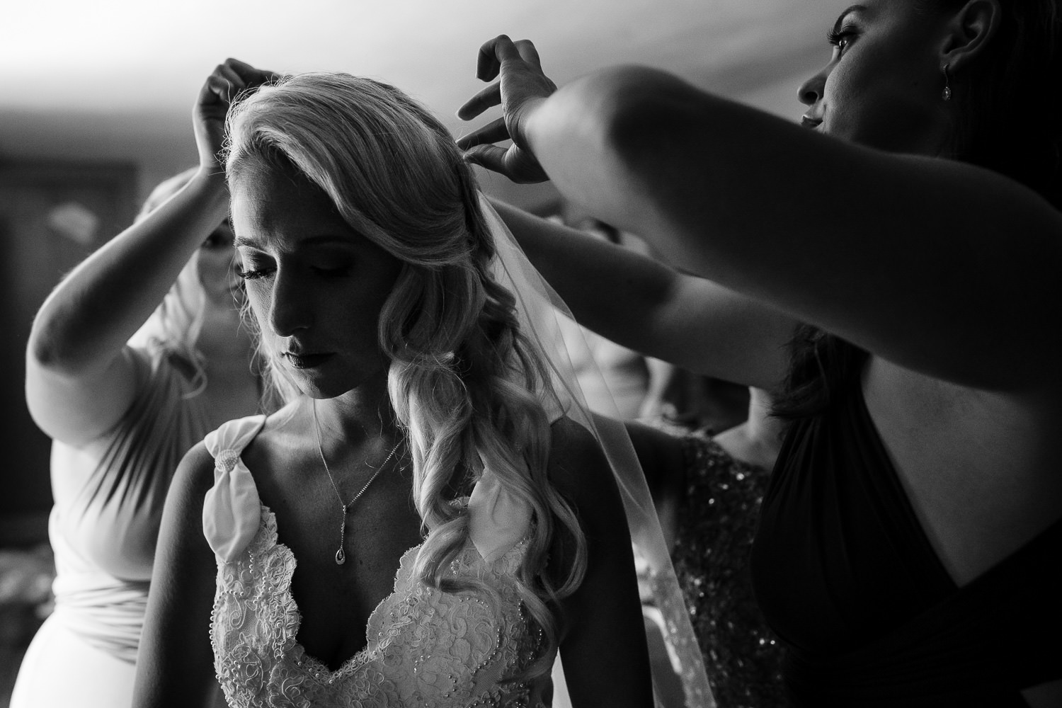 Bride as her veil is being put on