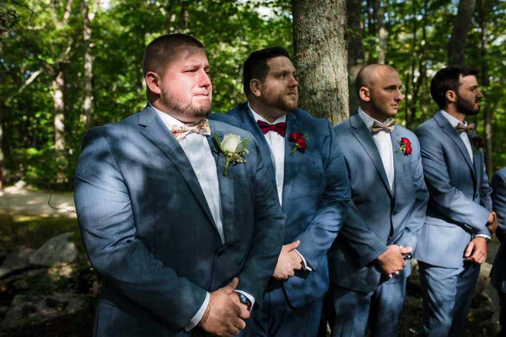 groom tears up as he sees bride