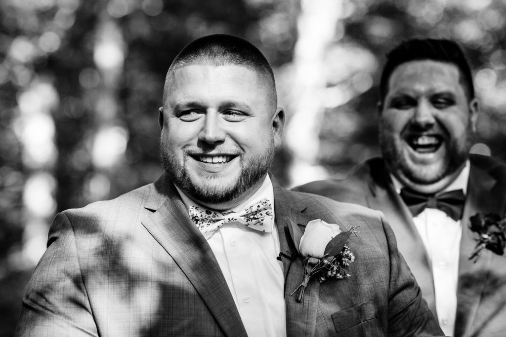 Groom smiles