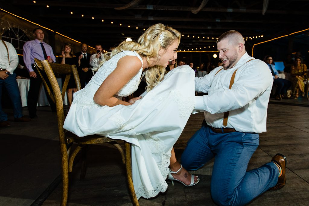 Groom gets brides garter