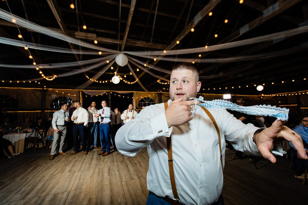 Groom tosses garter