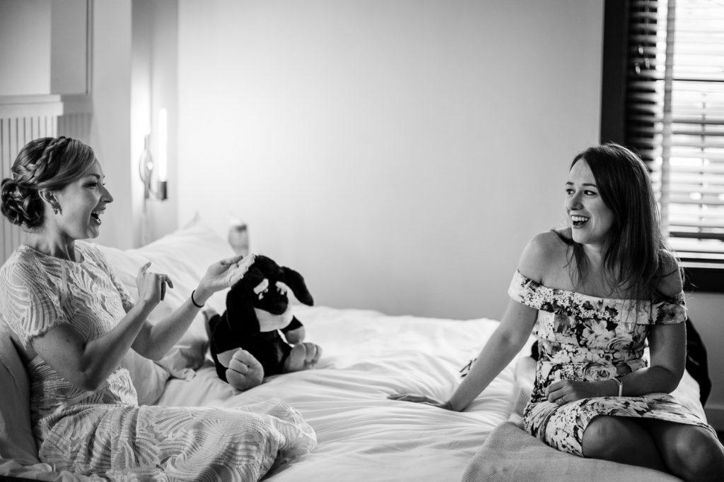 bride laughs with friend