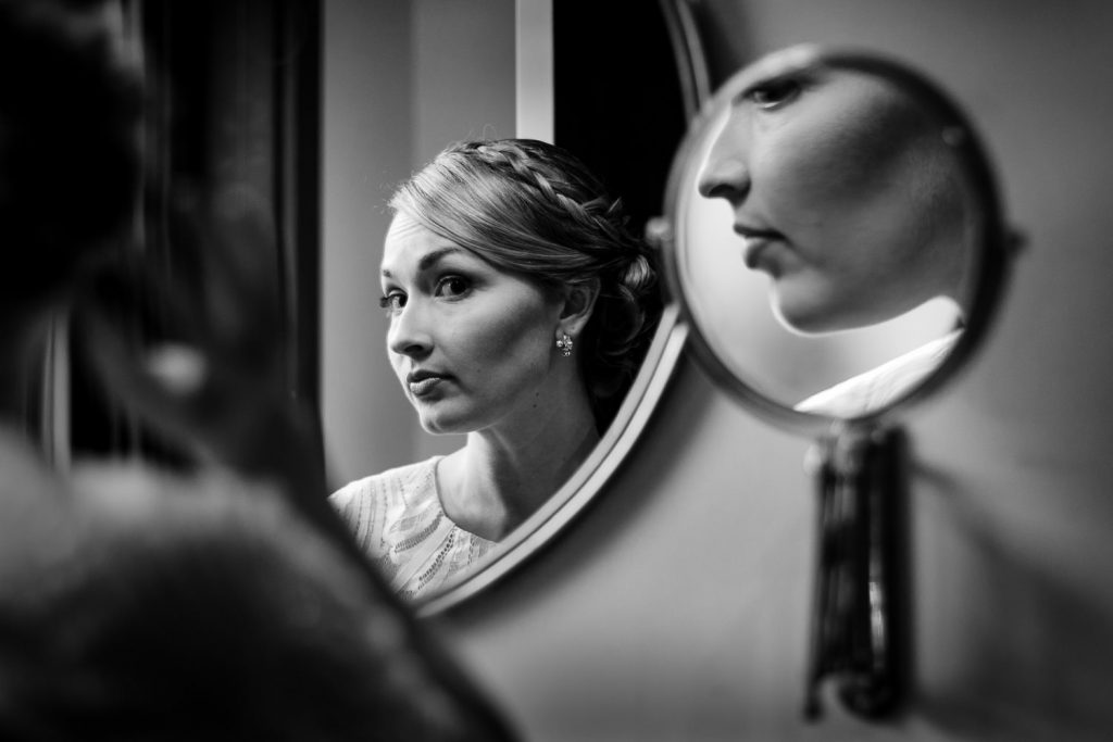 bride looks in mirrors at dean hotel