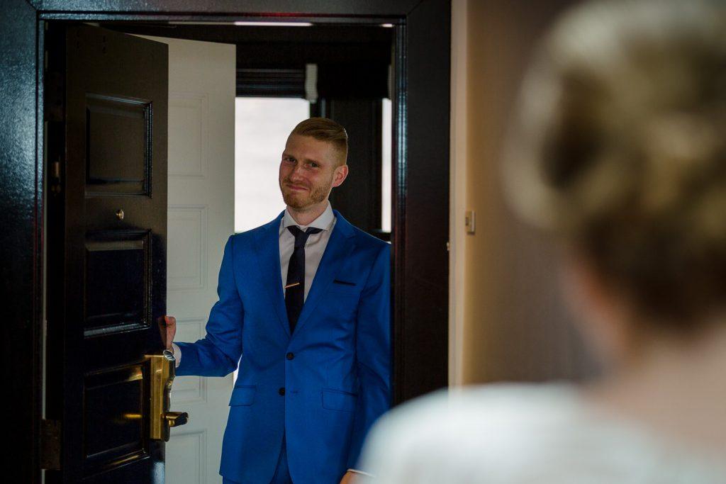 groom sees bride during first look
